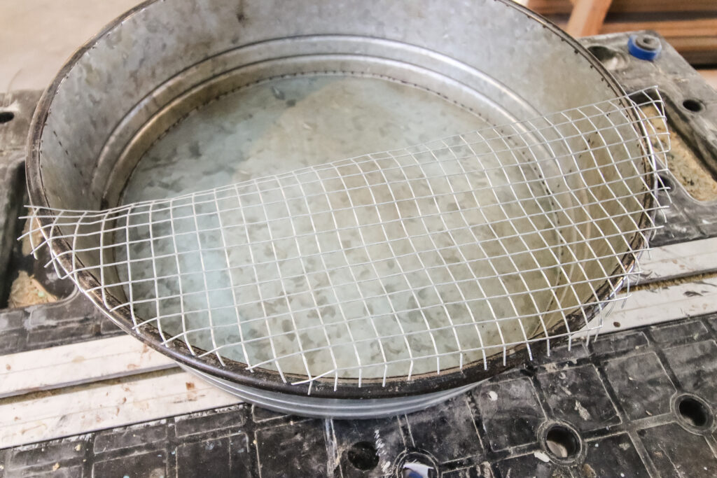 galvanized tray with metal mesh glued in place