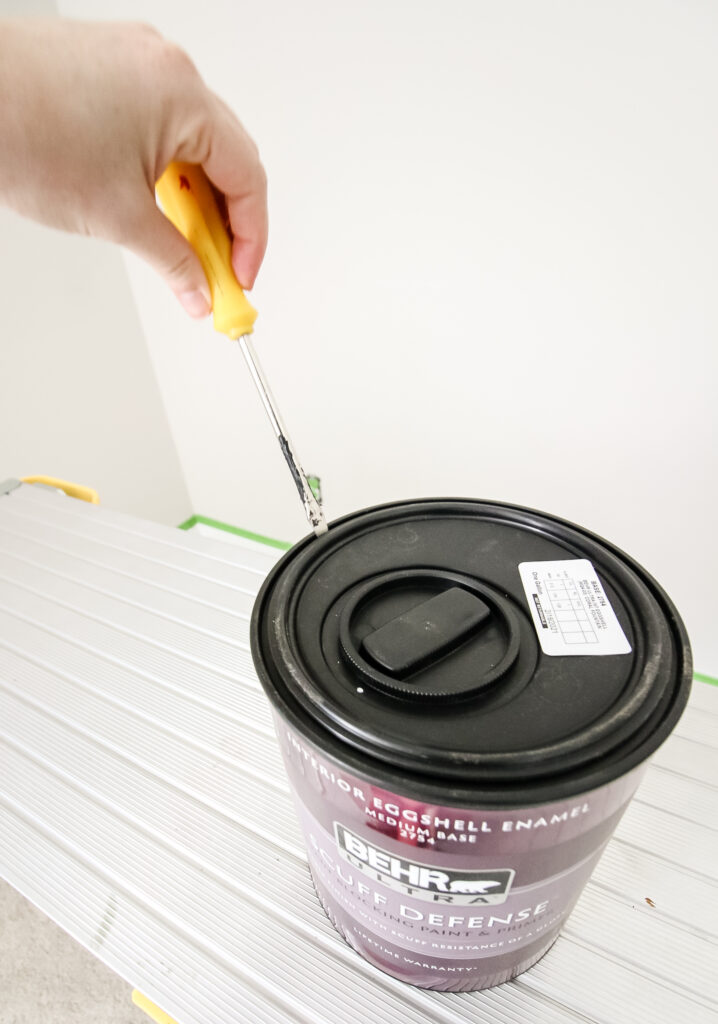 open a can of Behr paint with a screwdriver