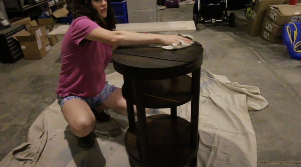 wiping wooden furniture clean after sanding