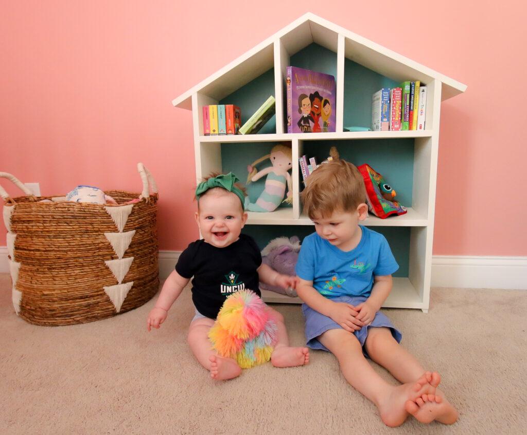 Luke and Rory with dollhouse bookshelf