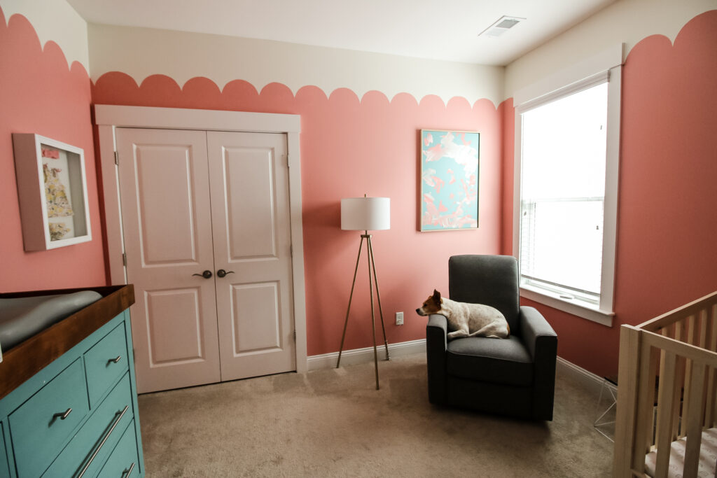 Wide angle shot of girls nursery with canvas