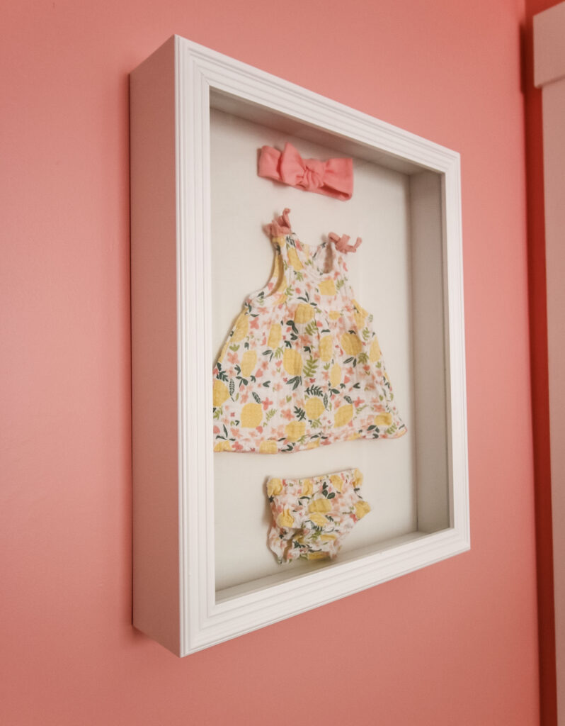How to display baby clothes in a shadow box