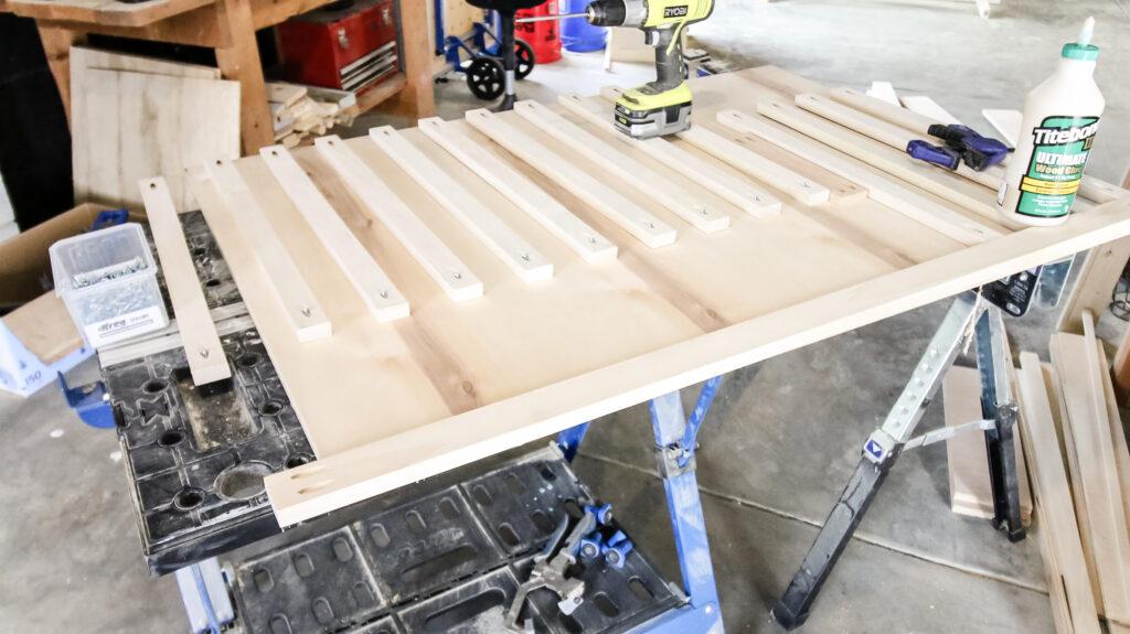 Attaching slats to rail