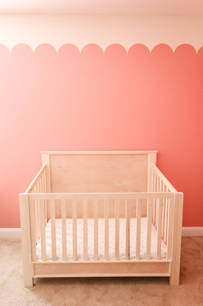 Full view of DIY crib with scallop wall