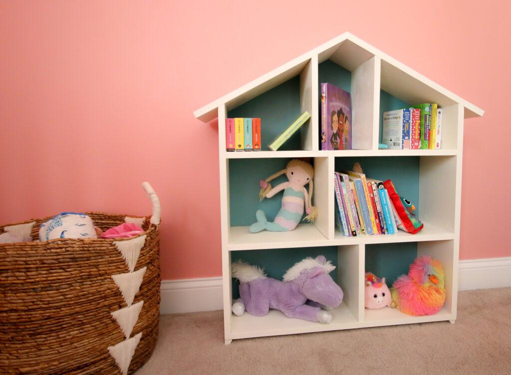 Dollhouse bookshelf with toy basket