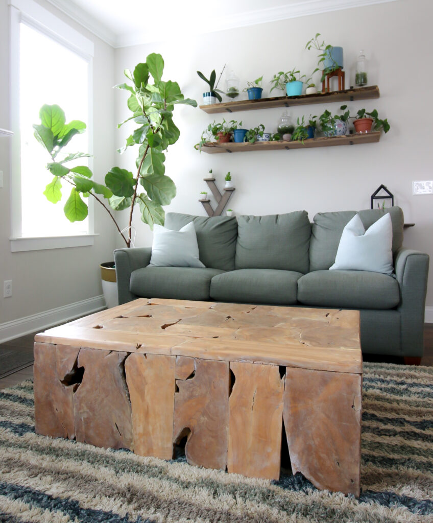 thrifted wood slice coffee table after makeover