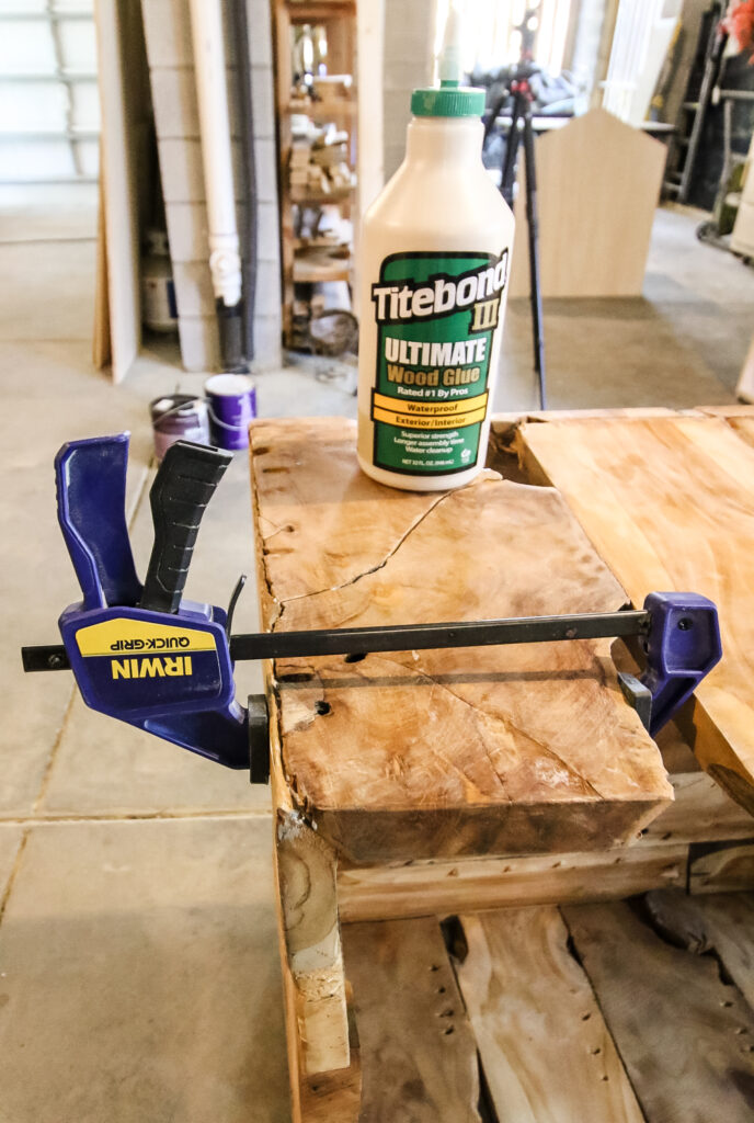 using wood glue and clamps to repair a wood table
