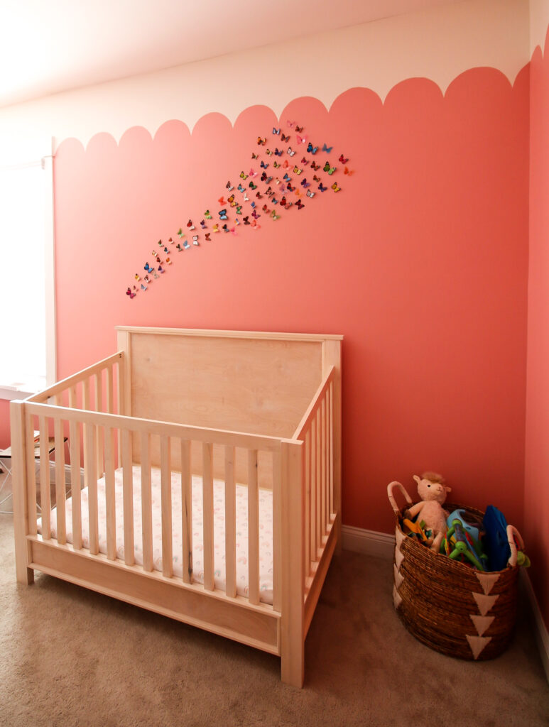 butterflies hanging on a wall over a crib
