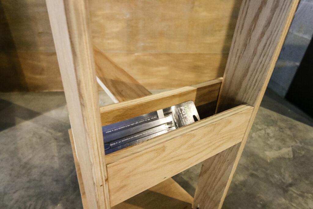 Storage bin on mobile scroll saw stand