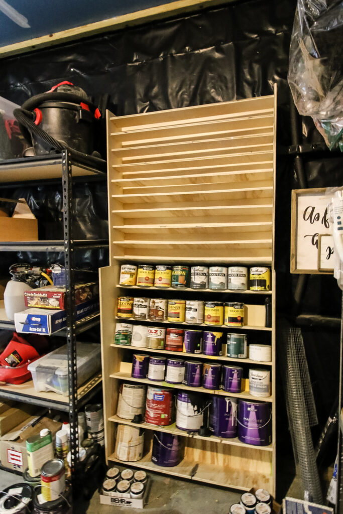 Attaching spray paint storage rack to wall