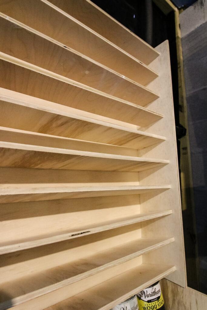 Close up of DIY spray paint storage rack