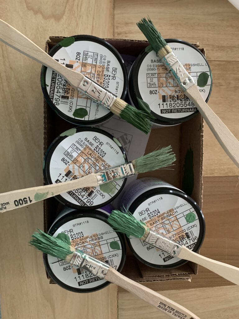 lots of samples of green behr wall paint