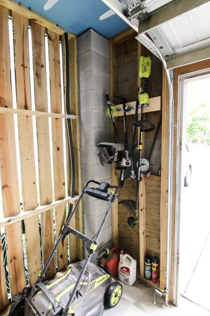 Outdoor power tools hanging in garage