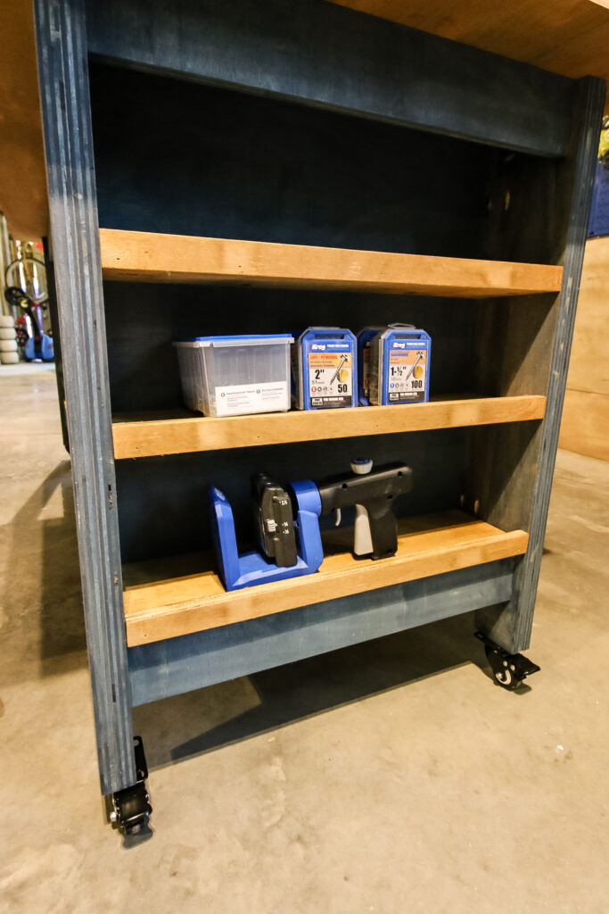 Shelving on mobile plywood workbench