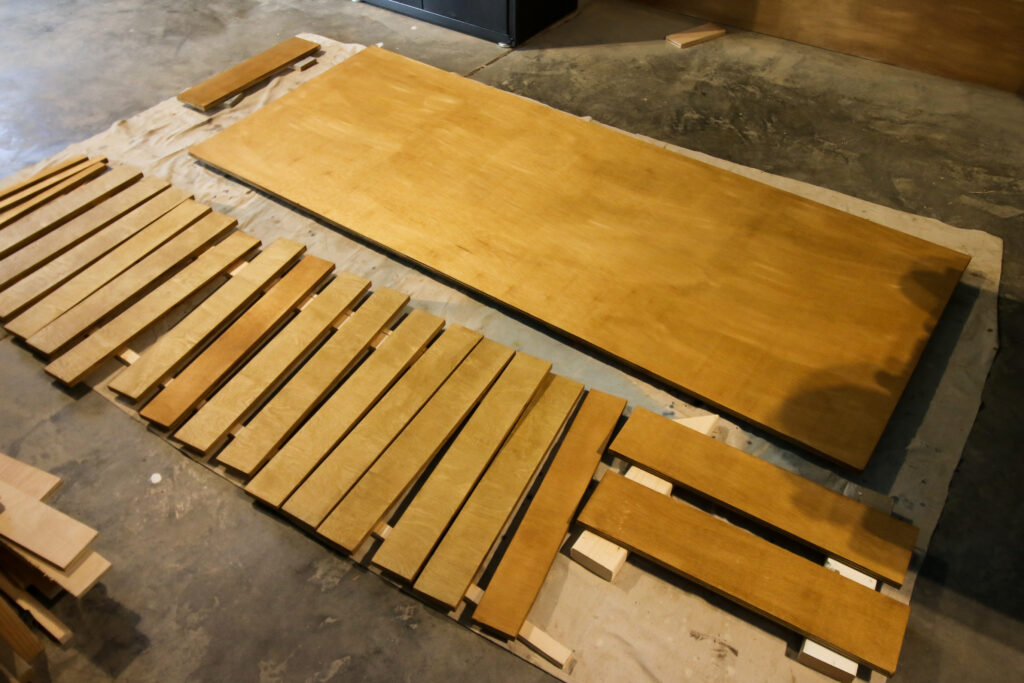 Plywood pieces cut from Adaptive Cutting System