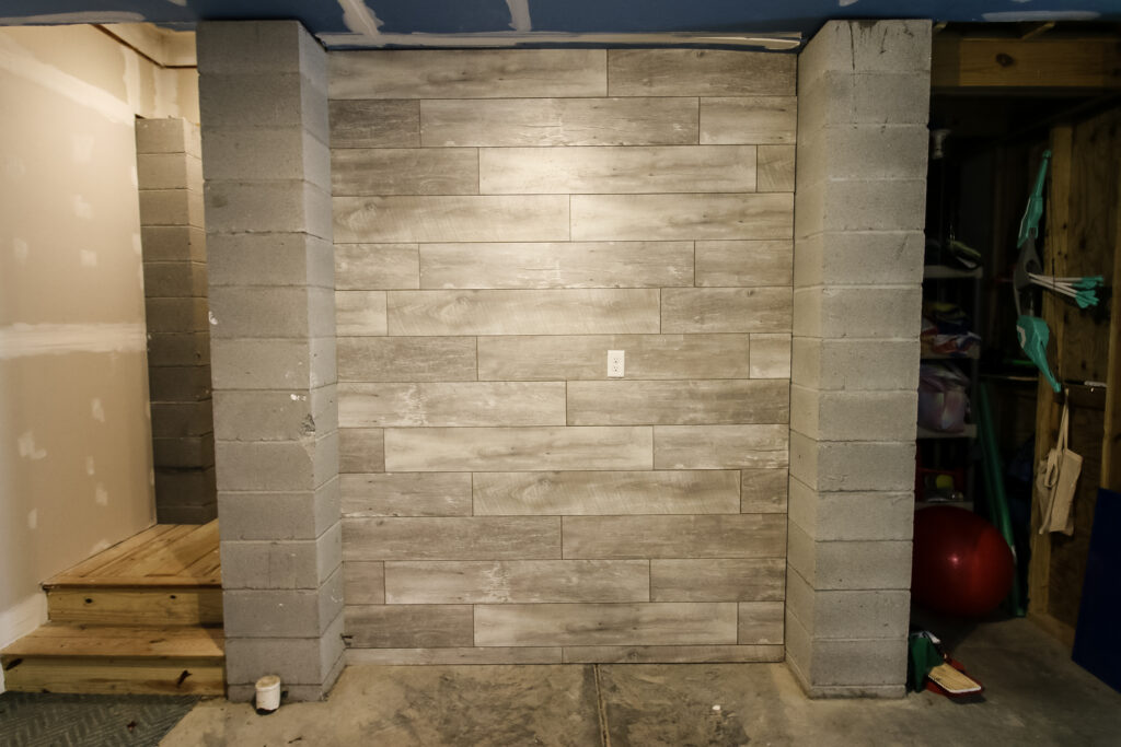 After photo of accent wall with laminate flooring