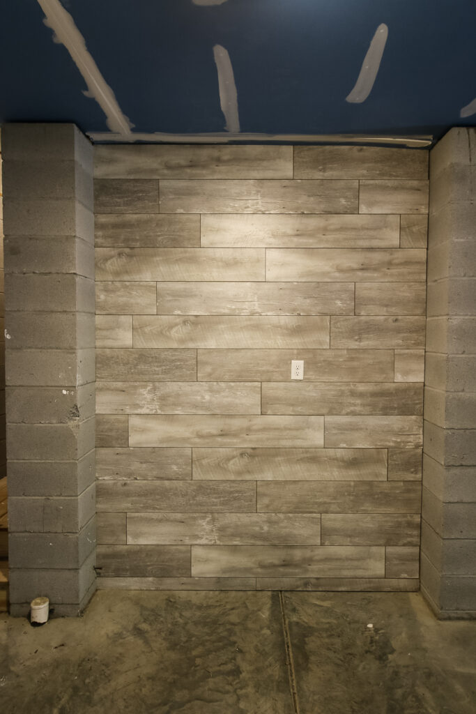 How to hang a laminate flooring accent wall - Charleston Crafted