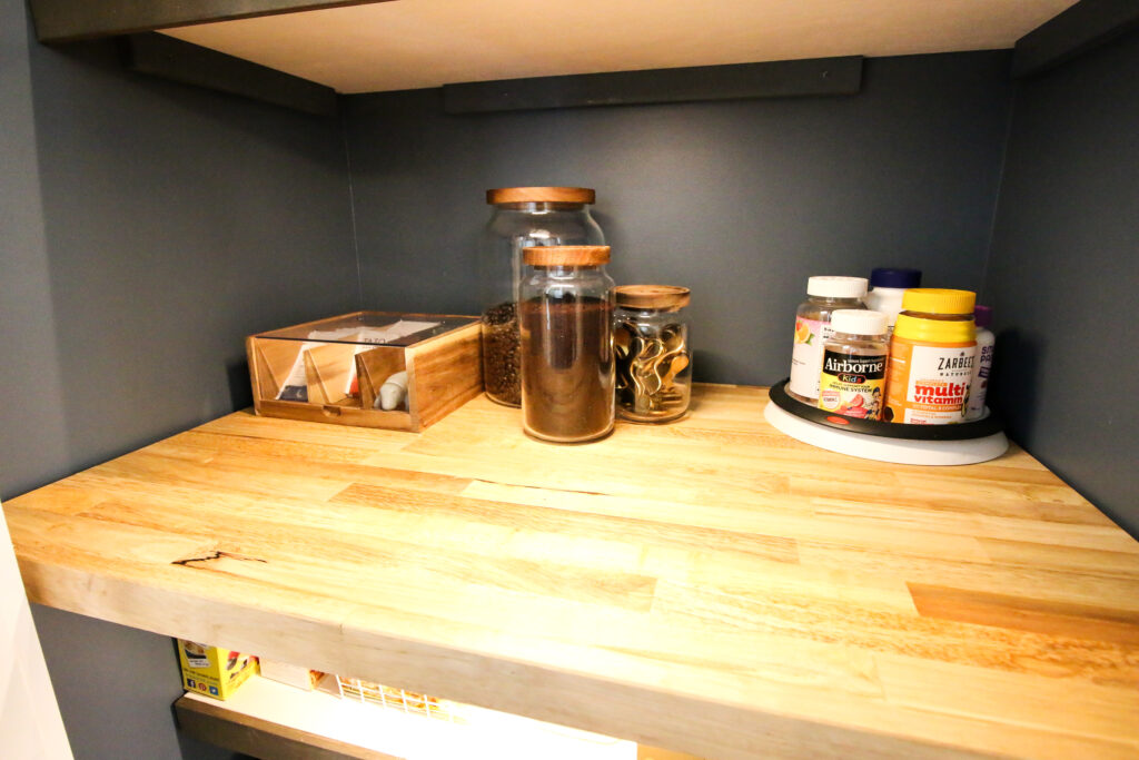 canister and tea organizer in a small pantry