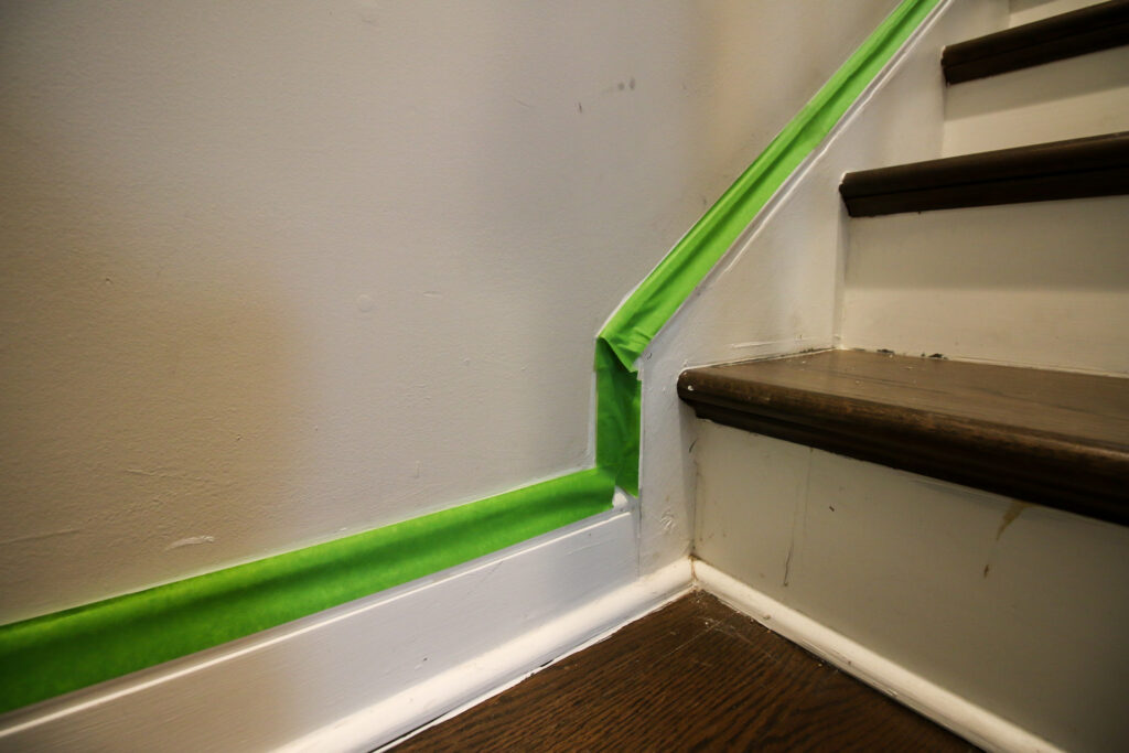 Applying painter's table to wall to paint before caulking