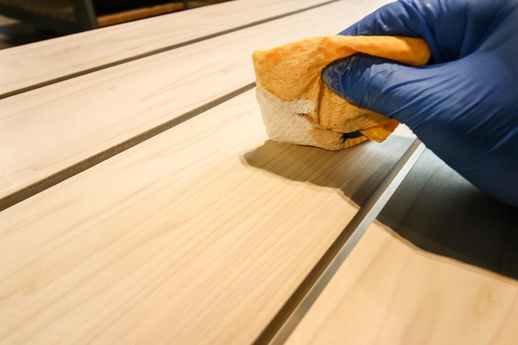 Buffing in Waterlox TRUETONE tung oil into coffee table