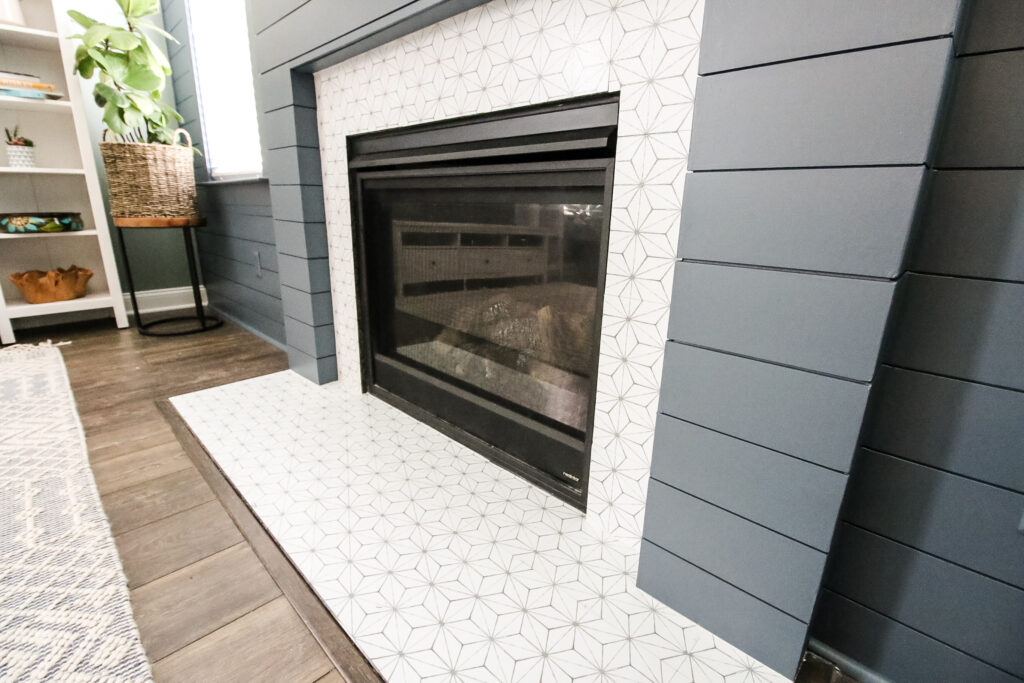 Tile stickers on fireplace granite surround