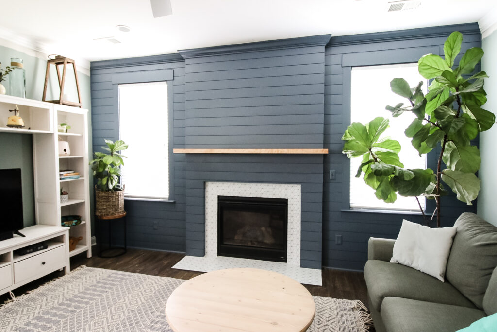 Full picture of shiplap fireplace and accent wall