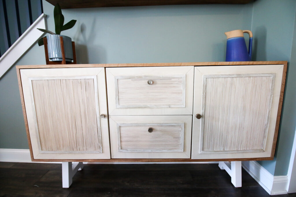Straight on picture of DIY buffet table with fluted doors