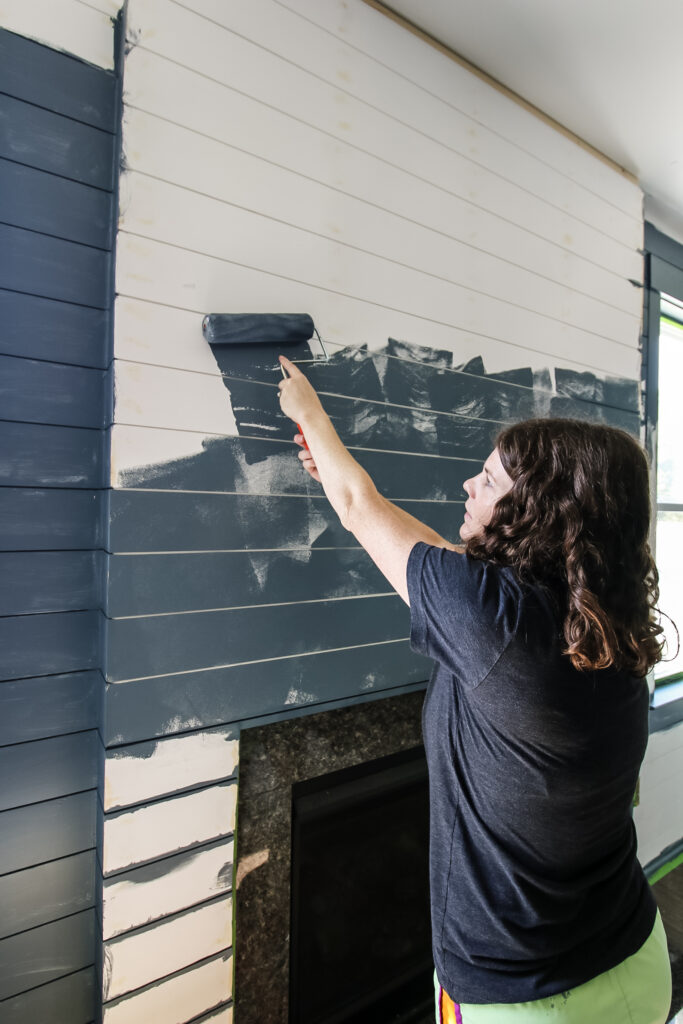 Painting shiplap boards with roller