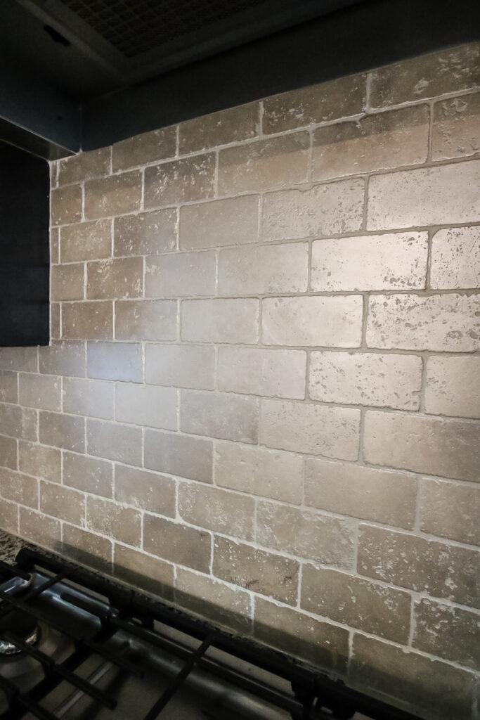 kitchen with painted tile backsplash