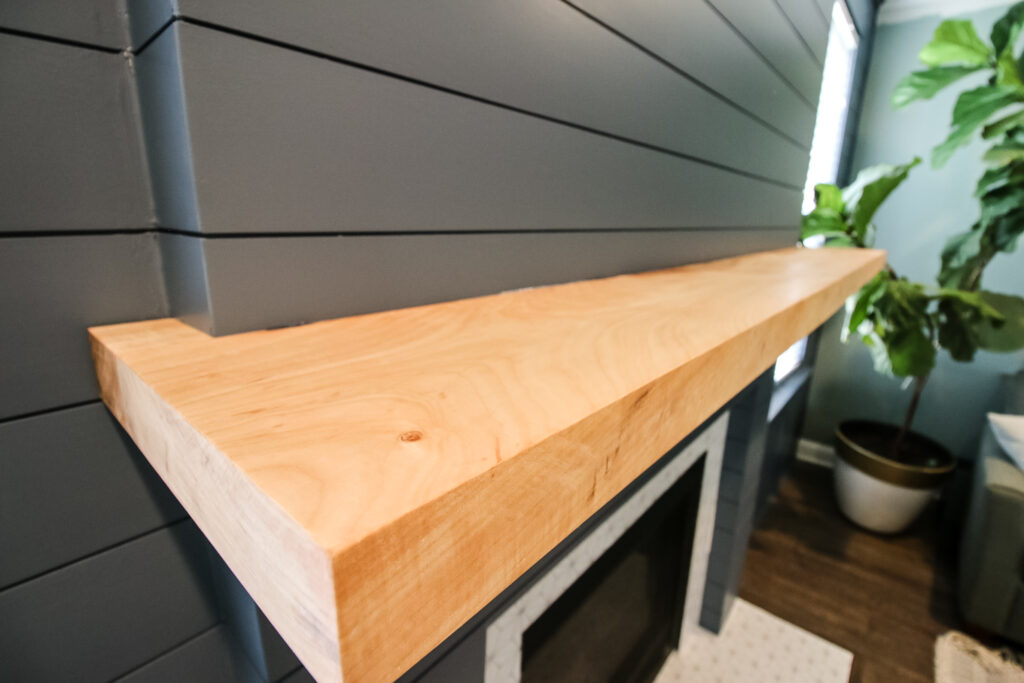 Close up picture of curly maple mantel