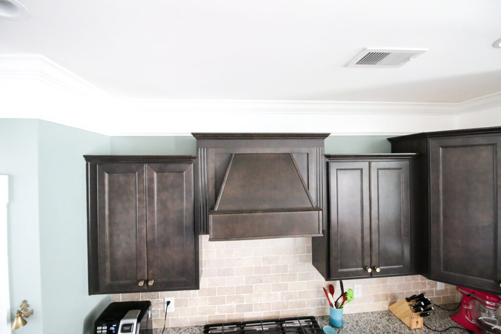 Extended crown molding above kitchen cabinets