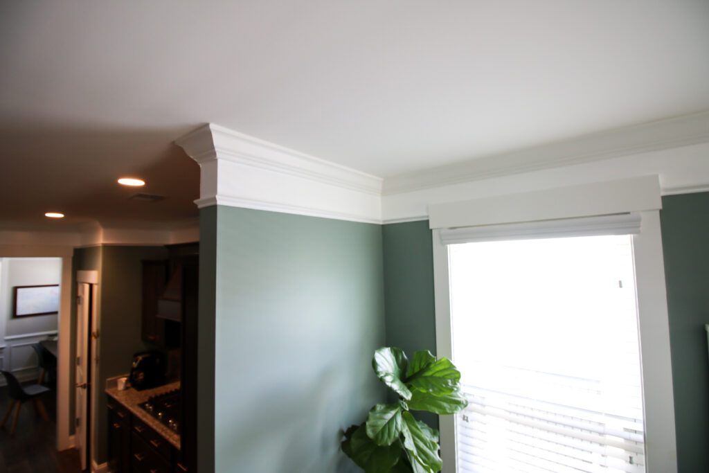 Crown molding expanded with paint and base cap molding