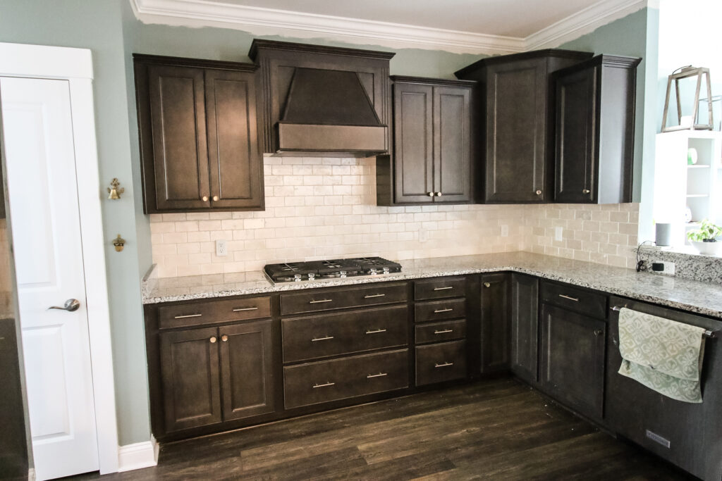 kitchen with painted travertine backsplash