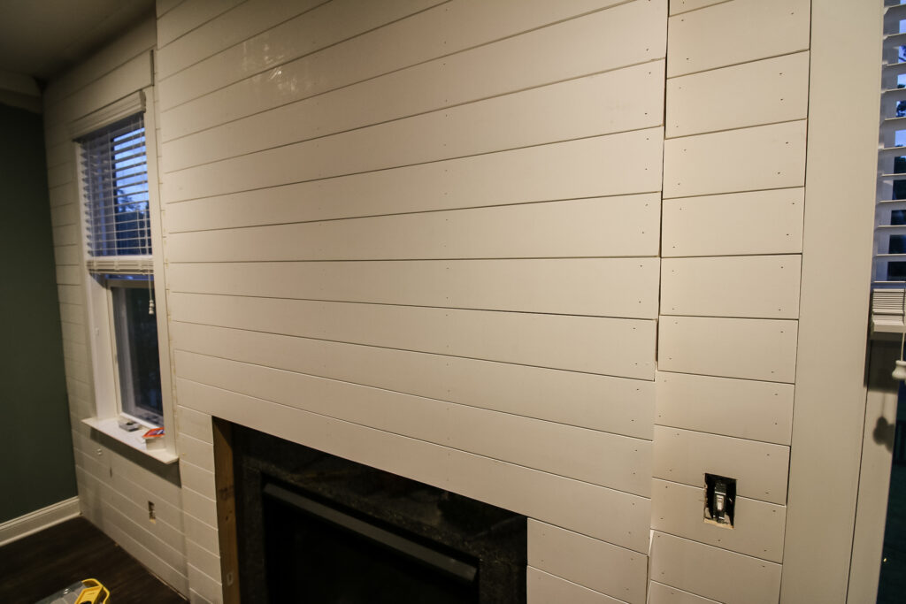 Shiplap boards once installed before finishing work