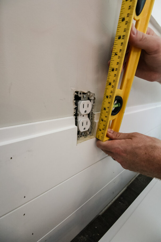 Measuring for outlet cutout on shiplap board