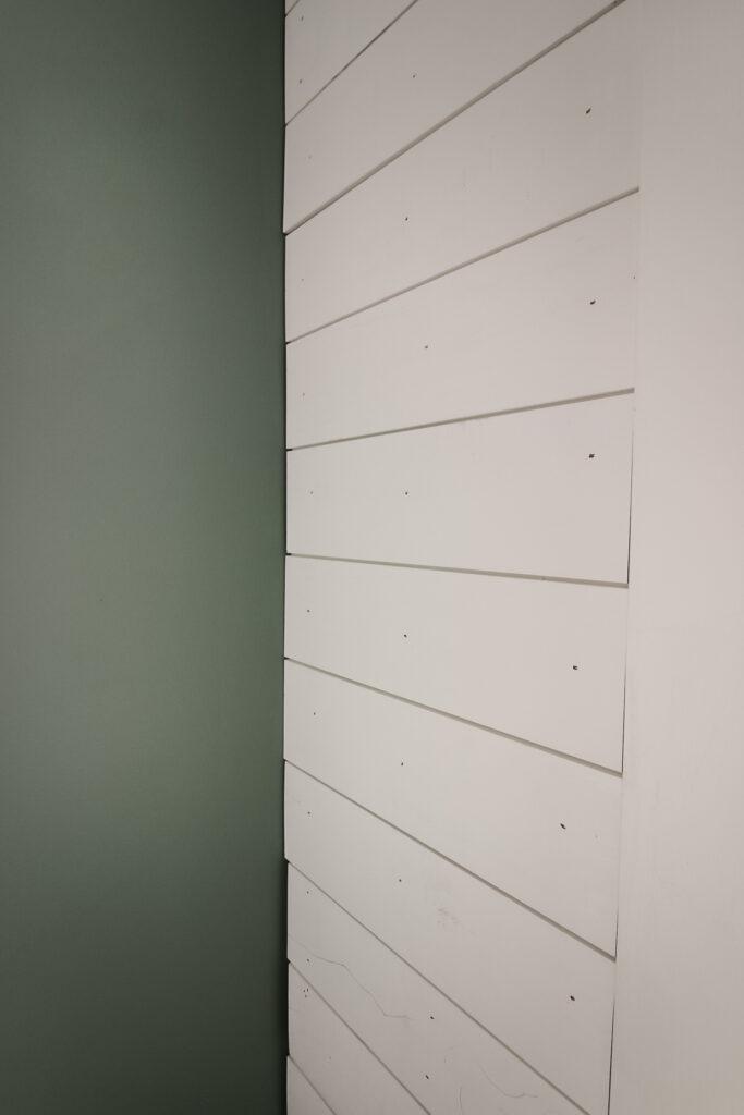 Installing shiplap boards on wall
