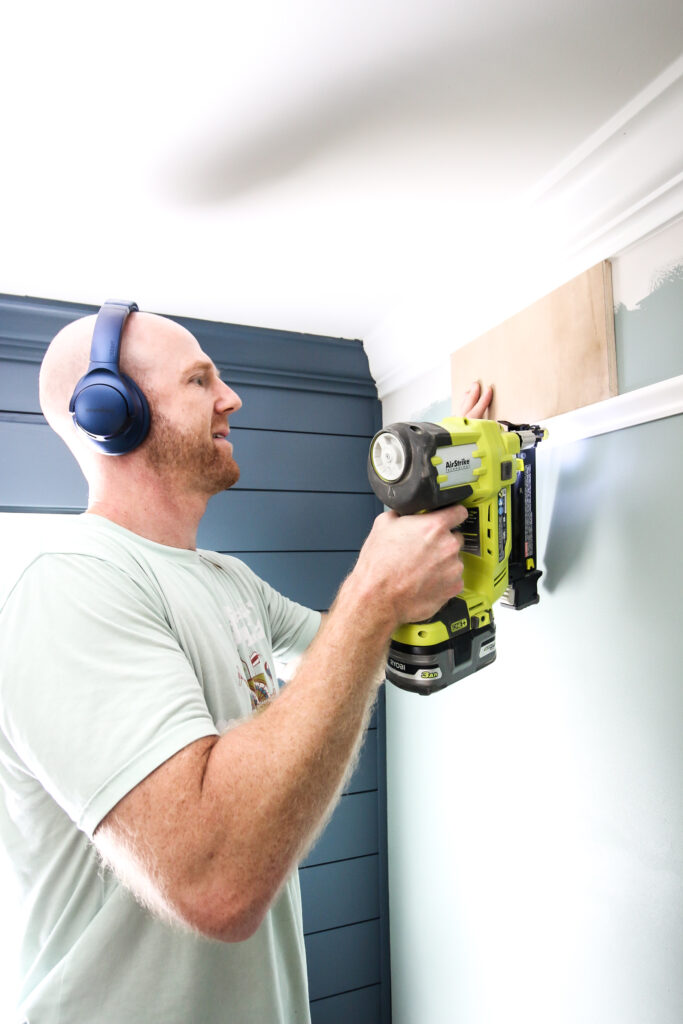 Using wood spacer for installing base cap molding